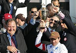 Trainer Richard Dutrow Jr. in the Kentucky Derby winner's circle after Big Brown's victory in 2008.
