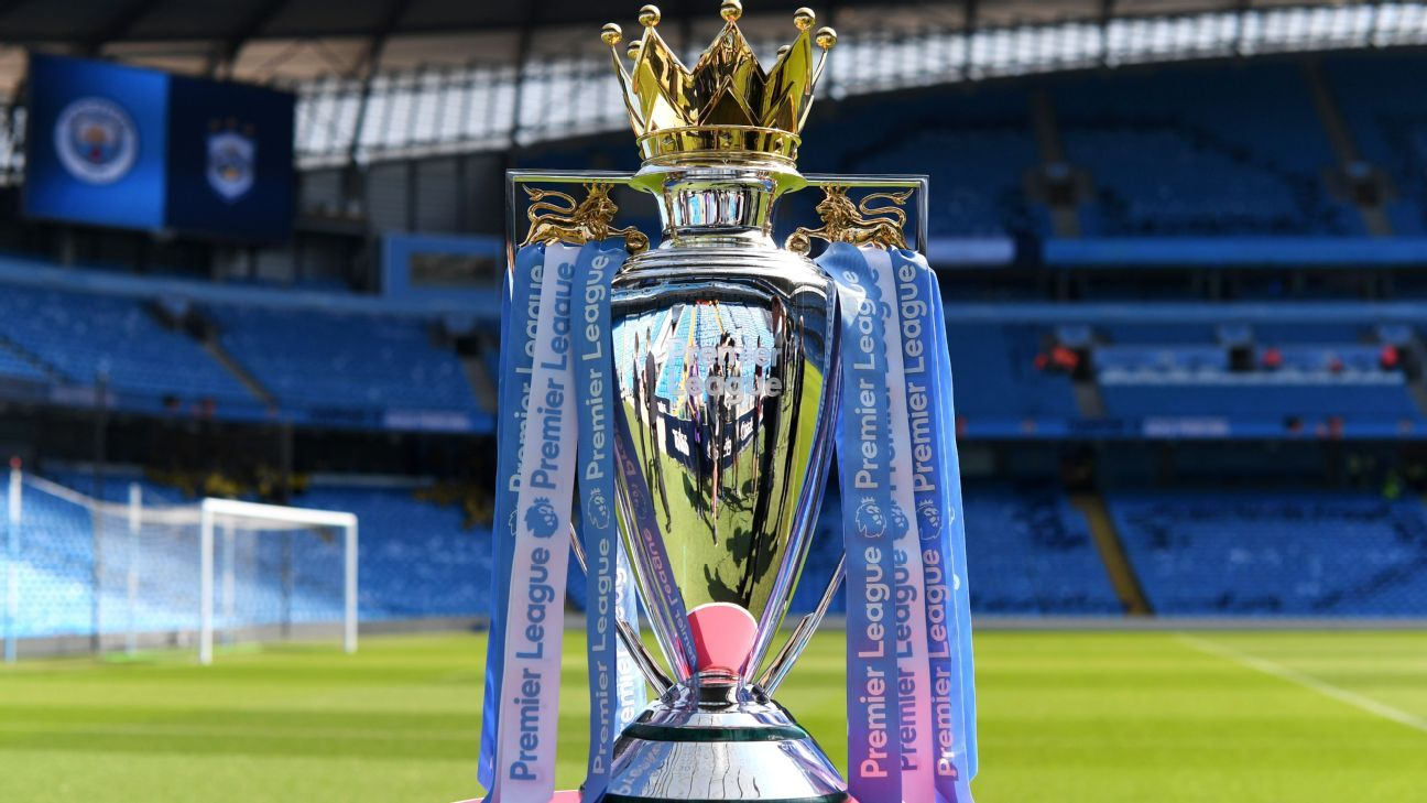 The Premier League trophy decked out in colours of 2017-18 champions Manchester City