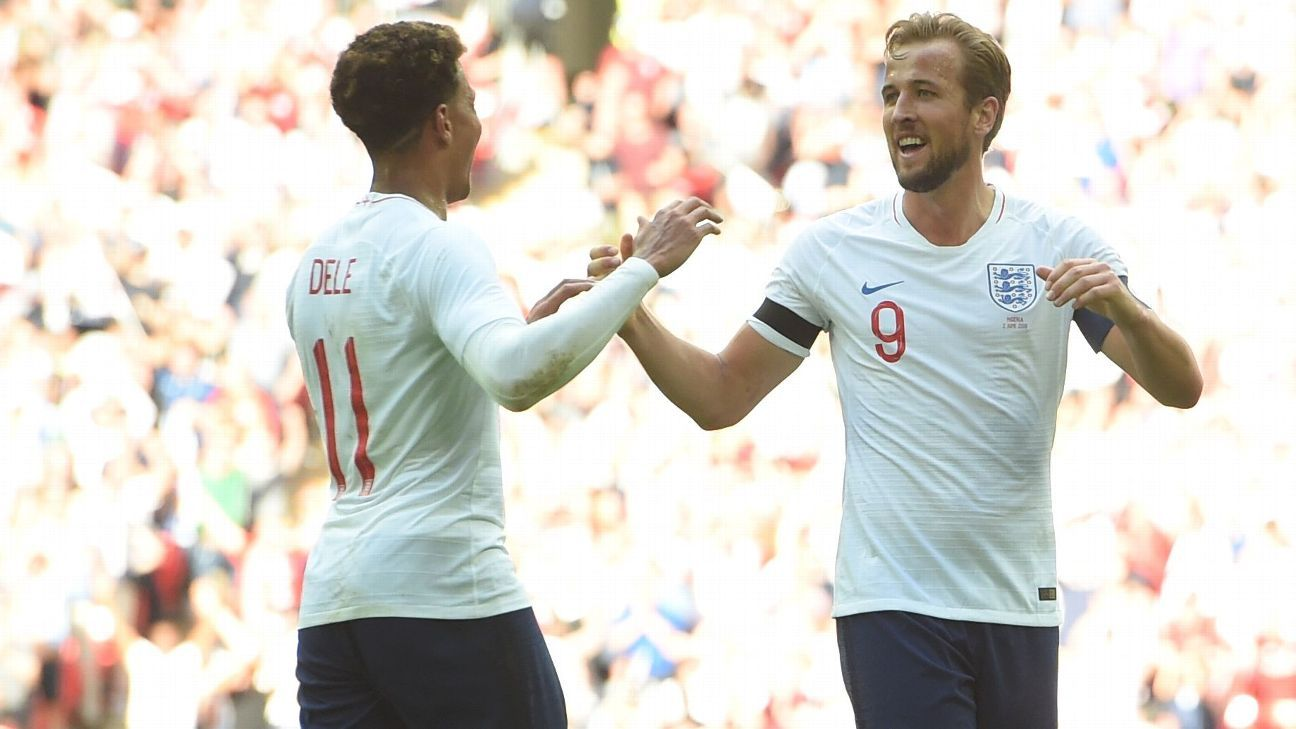 Harry Kane celebrates with teammate Dele Alli after scoring England's second.