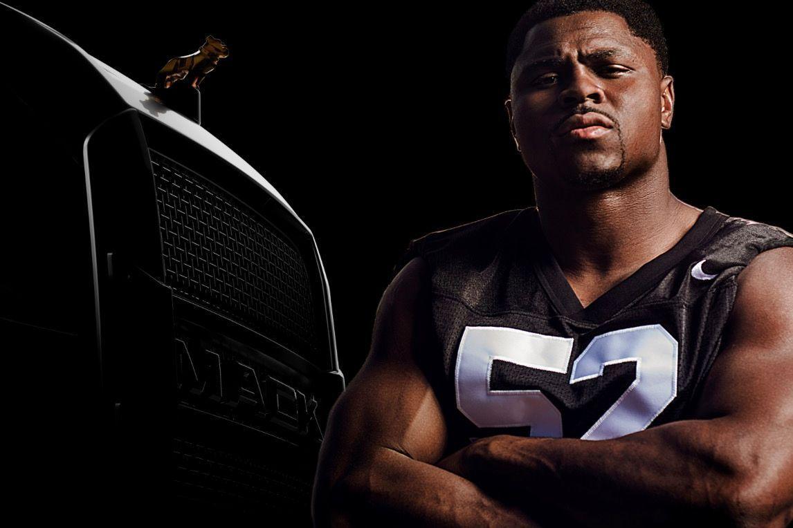 Khalil Mack of Oakland Raiders signs to endorse Mack Trucks