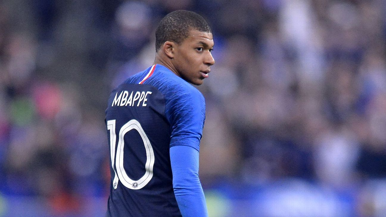 France's Kylian Mbappe leaves training after tackle from