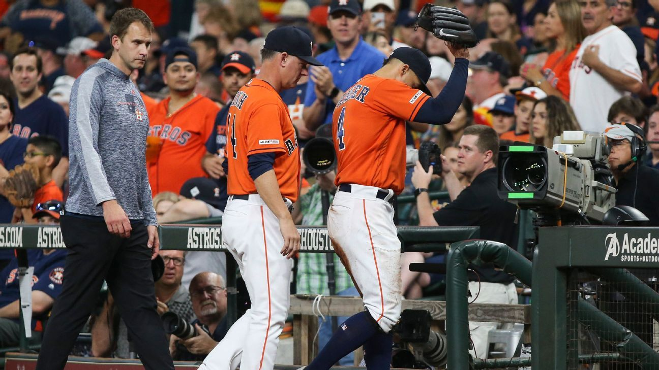 Astros right fielder George Springer injured his left hamstring chasing a foul ball and left Friday night's game against the Red Sox in the eighth inning. Manager AJ Hinch said it's likely Springer will be placed on the injured list.