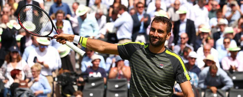 Defending champ Cilic through at Queen's Club