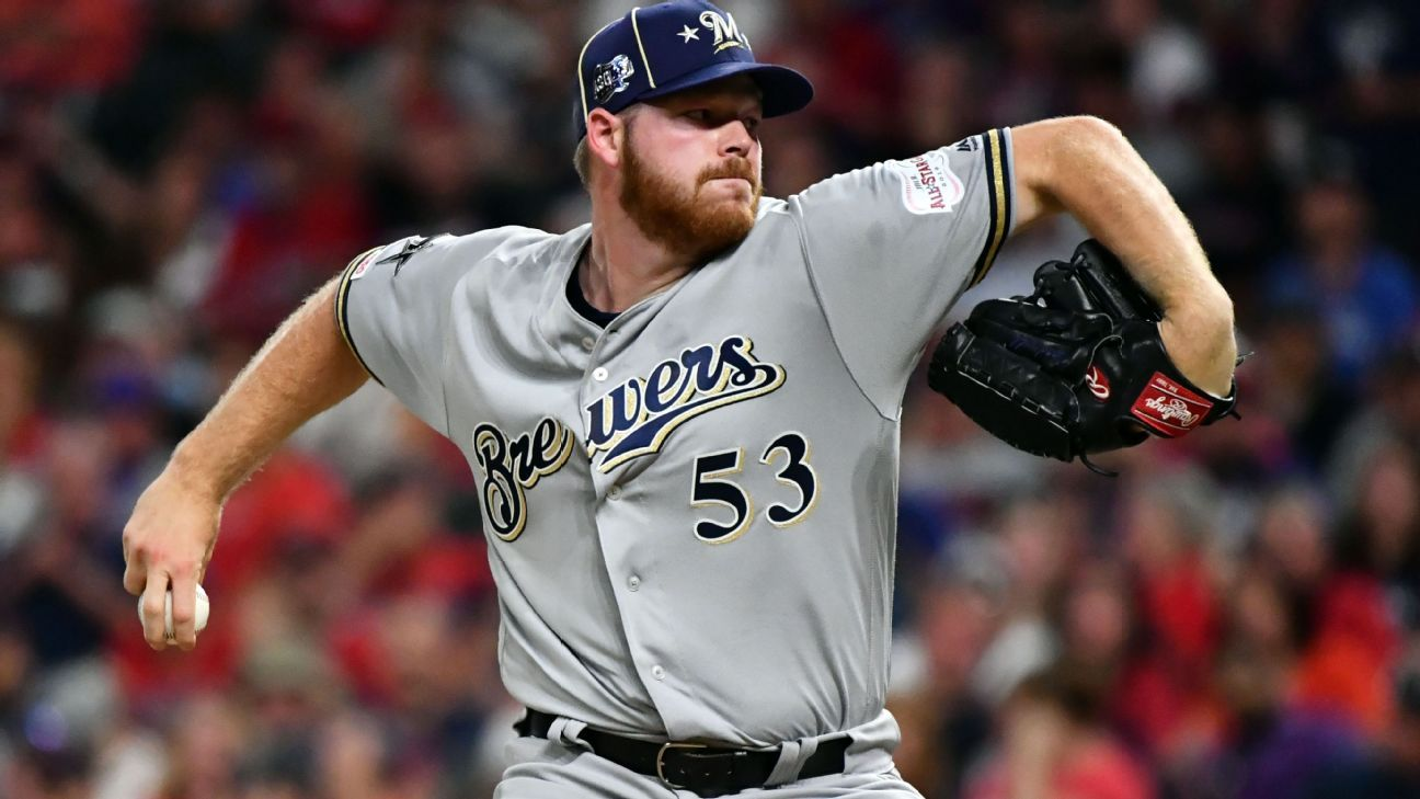 Brewers ace Woodruff exits with abdominal injury