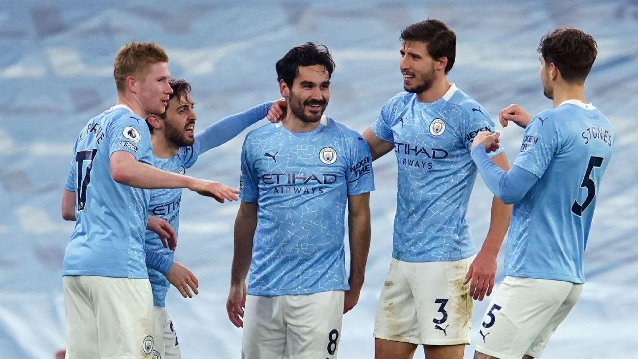 Man City beat Palace to stay on Man Utd's heels