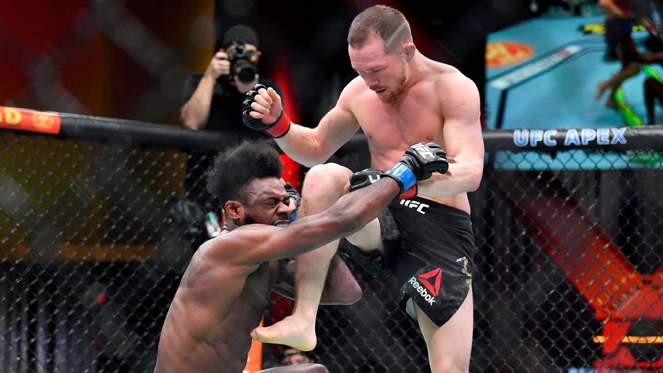 Aljamain Sterling wins UFC bantamweight title after Petr Yan disqualified for illegal knee - ESPN