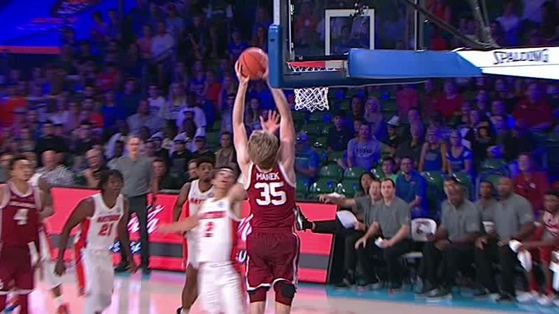 Oklahoma's Manek catches lob from half court and throws it down