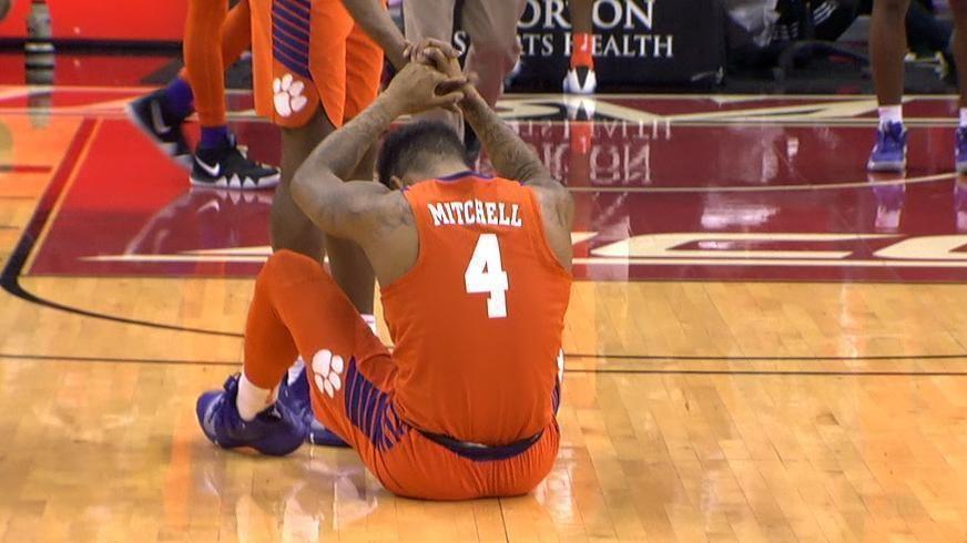 No. 16 Louisville avoids late disaster, beats Clemson 56-55
