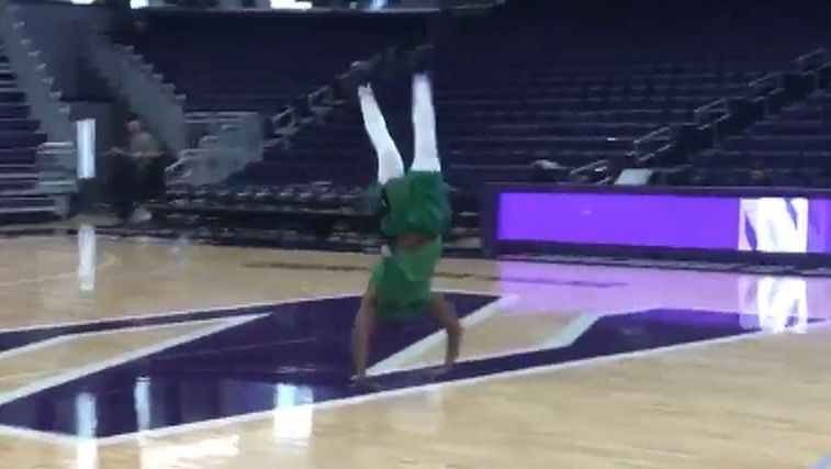 Brown does back flip after hitting half-court shot