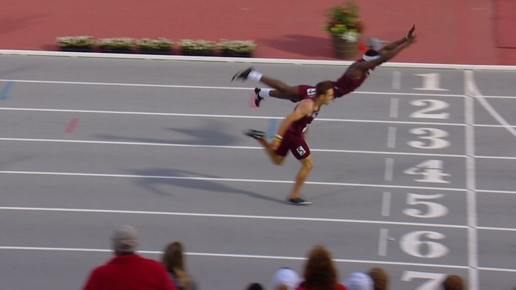 Texas A&M hurdler dives for finish to beat teammate