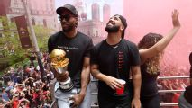 Drake chugs beer on Raptors parade bus