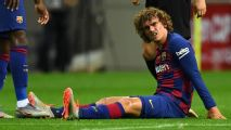 Concern for Barcelona as Griezmann goes down injured