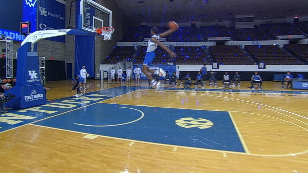 Kentucky freshman takes off just inside the foul line for windmill jam