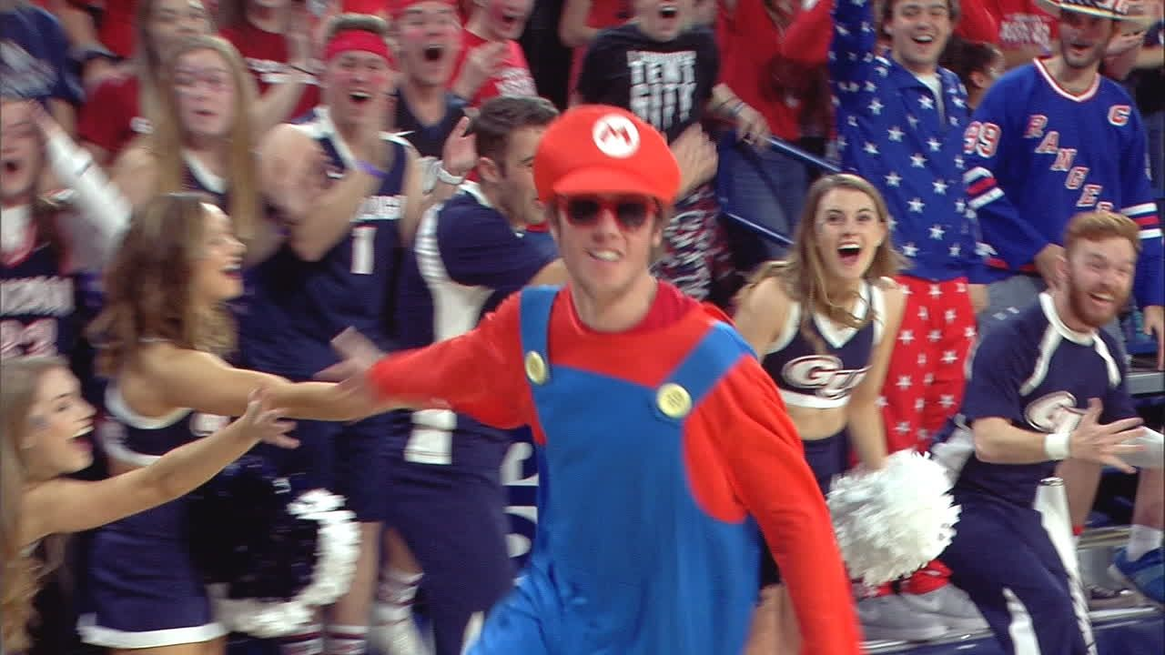 Student in Mario costume nails half-court shot