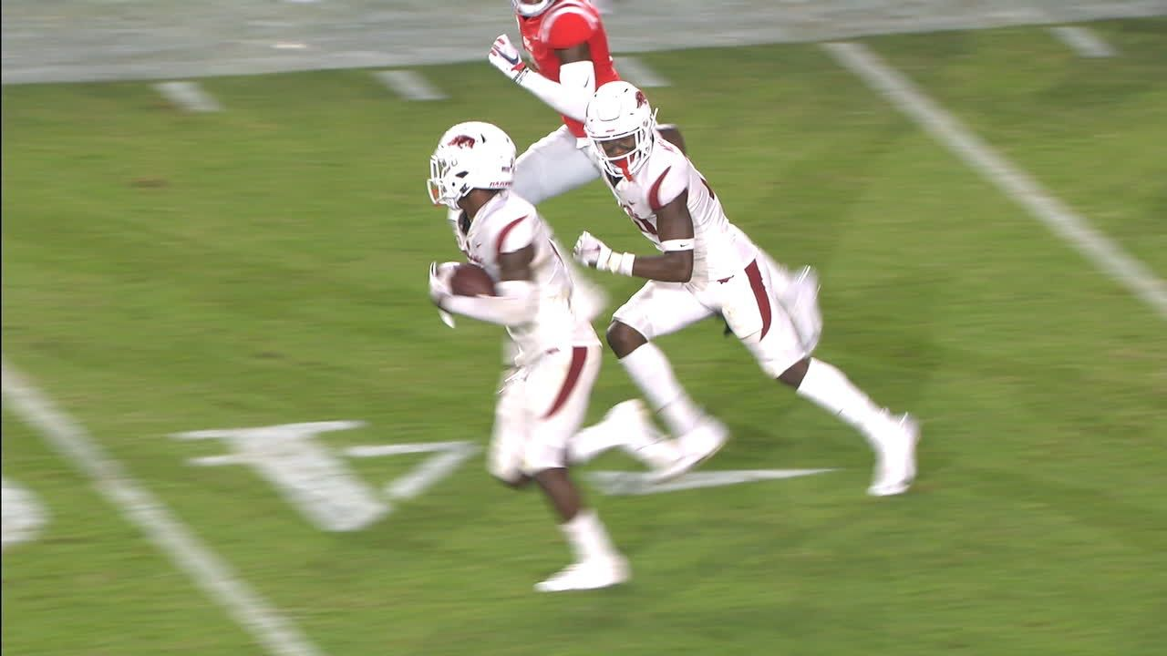 Arkansas defender rips ball free, takes it to the house