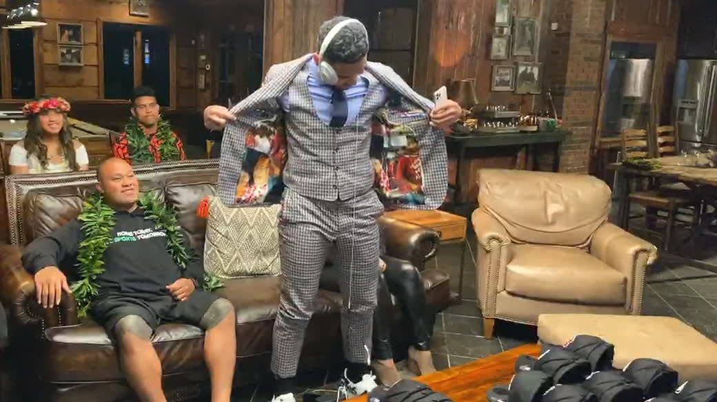 Tua shows off flashy suit after being taken by Dolphins