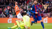 Messi brace as Barcelona keep pressure on Real with easy win