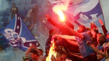 Violent clashes between fans, police mar start of season in Russia