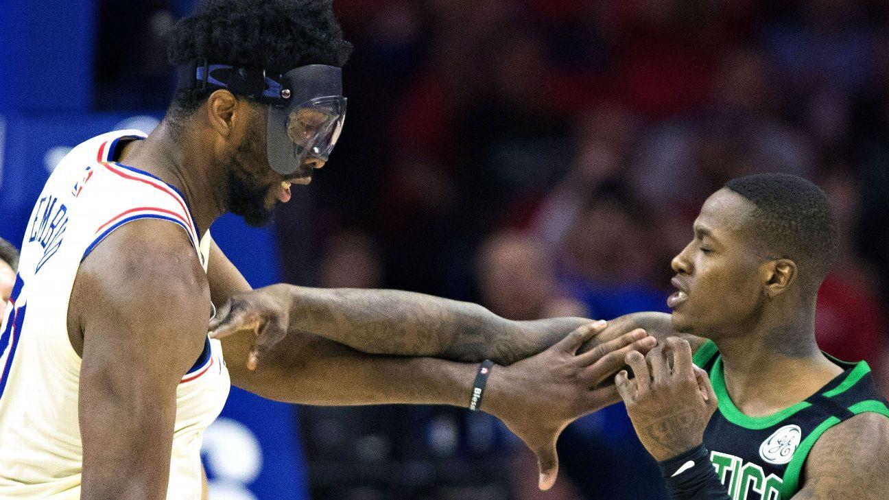Philadelphia 76ers' Joel Embiid and Boston Celtics' Terry ...
