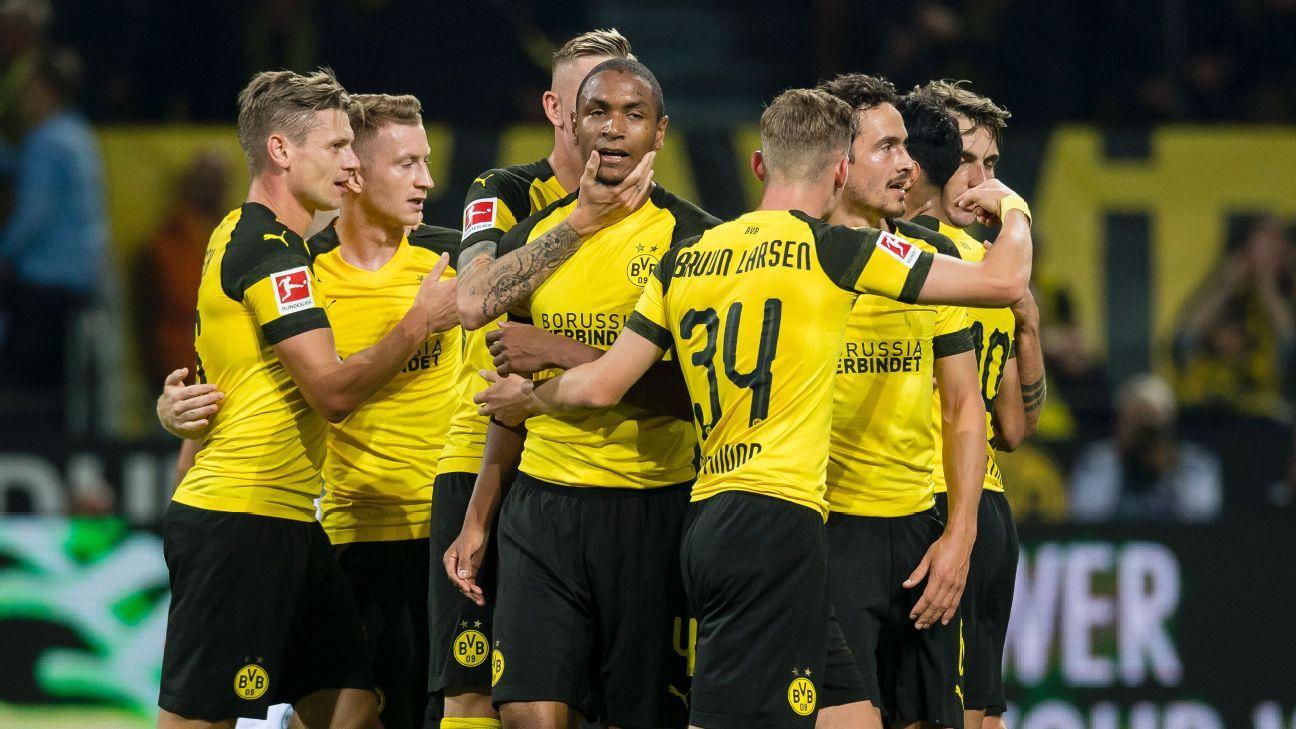 Second-half goals lead Borussia Dortmund over Eintracht Frankfurt