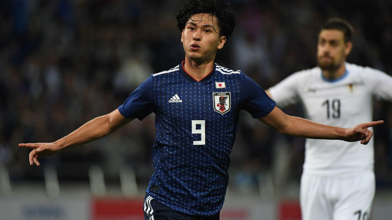 Takumi Minamino scores twice as Japan beat Uruguay in thriller
