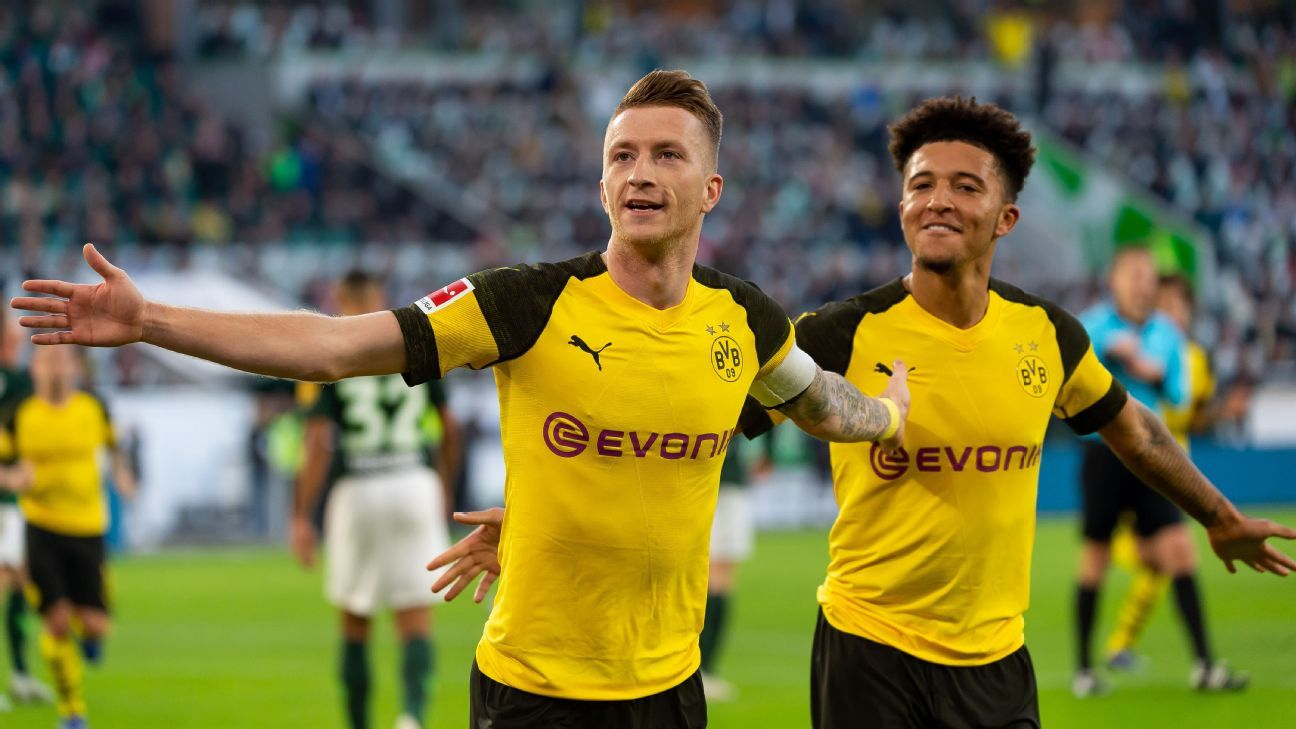 Marco Reus strikes to send Borussia Dortmund four points clear with win at Wolfsburg