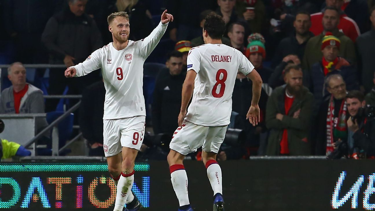 Denmark beat Wales to earn promotion to Nations League top tier