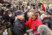 Harbaugh: Controversy followed Urban Meyer