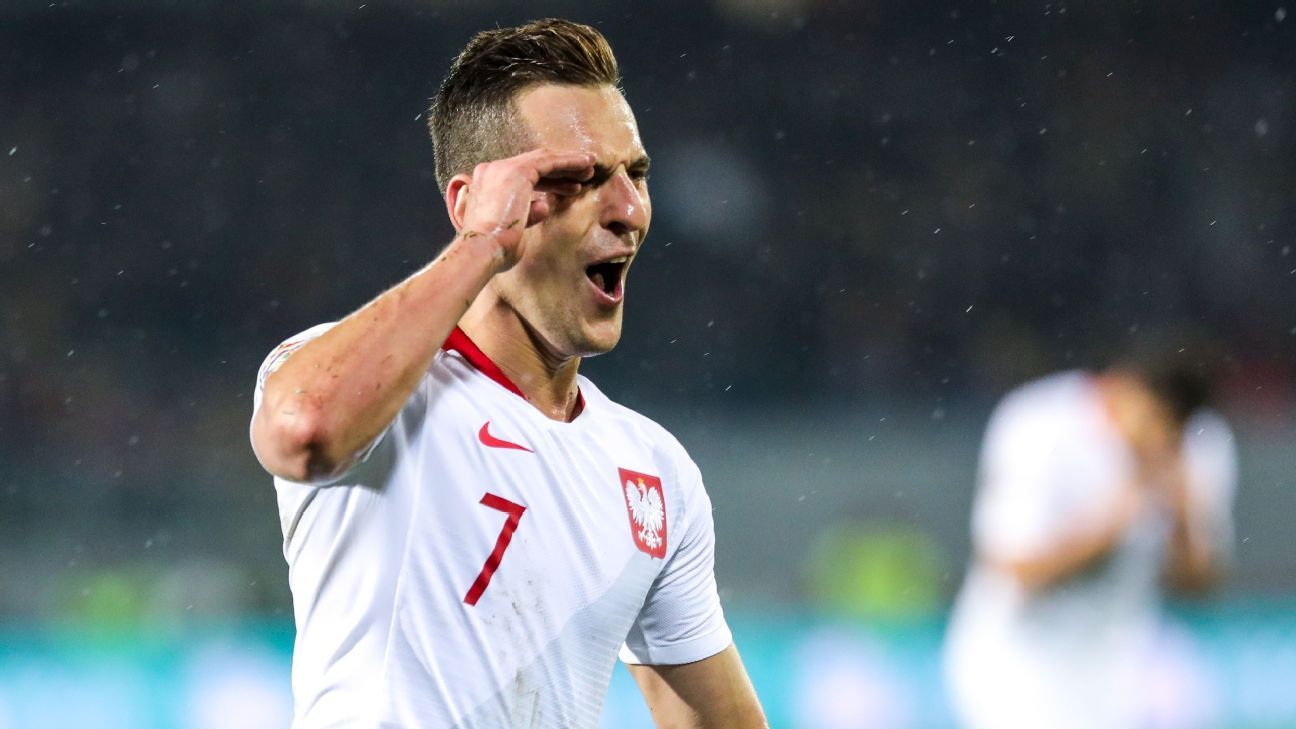 Arkadiusz Milik's twice-taken penalty gives relegated Poland draw in Portugal
