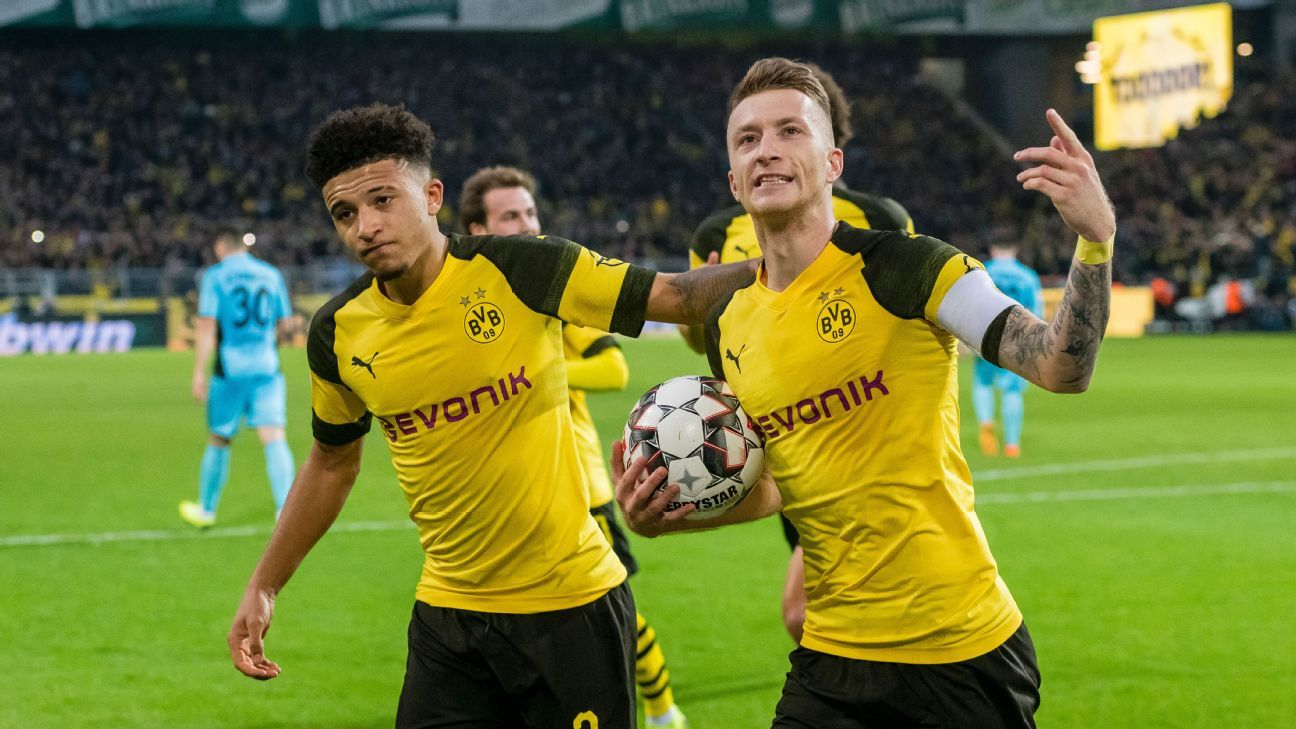 Leaders Borussia Dortmund made to sweat for 2-0 win over Freiburg