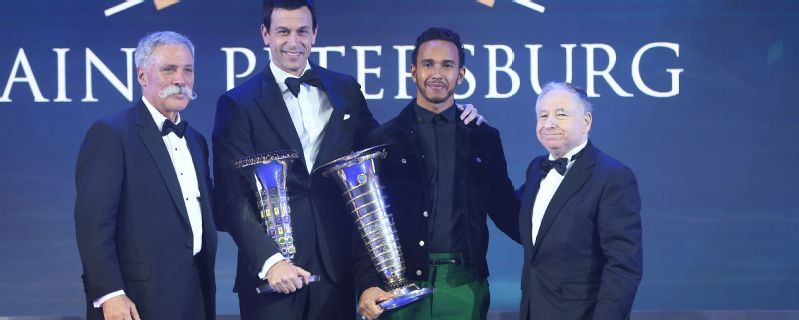 Lewis Hamilton collects champion's trophy and aims for more