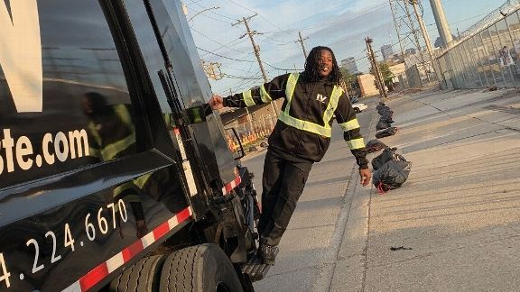 Alvin Kamara moonlighting as a trash collector? Well, sort of.