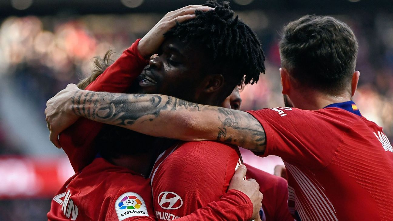 Atletico put pressure on Barca with 2-0 win as Getafe see red