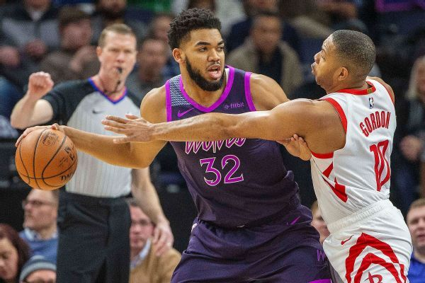 Karl-Anthony Towns still in concussion protocol, travels with team