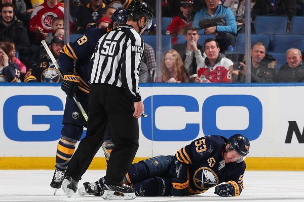 Sabres' Jeff Skinner helped off ice after hurting leg, later returns