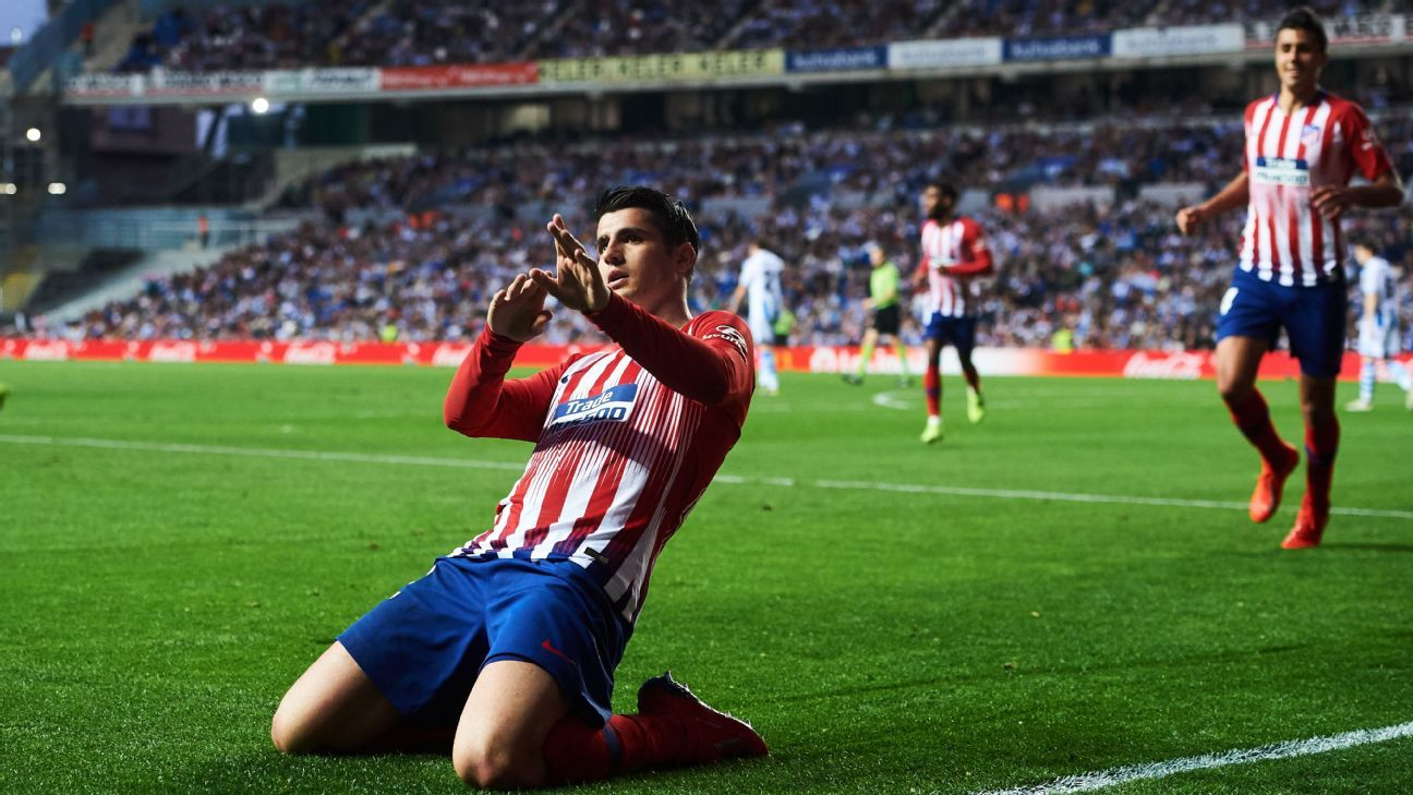Morata double keeps up 10-man Atletico close to leaders Barcelona