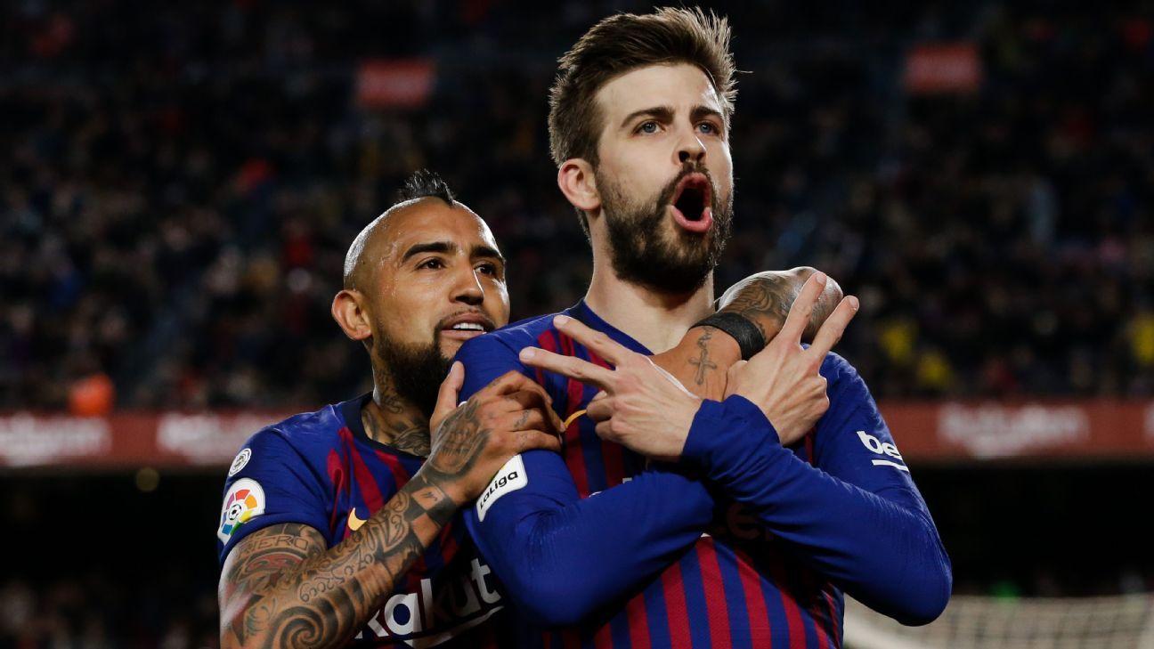 Pique, Messi, Suarez score Barcelona's win over Rayo Vallecano