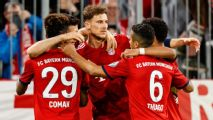 Lewandowski double helps 10-man Bayern edge German Cup thriller