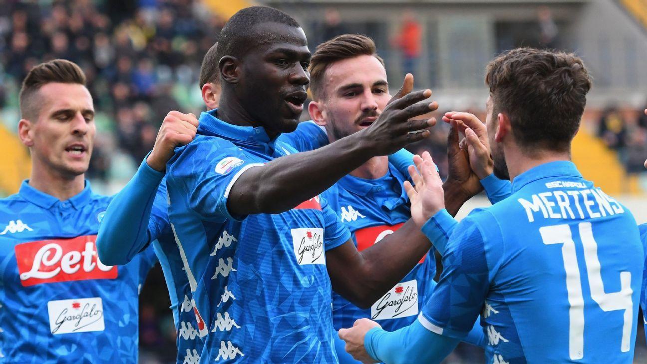 Napoli win to delay Juventus title celebrations and send Chievo down