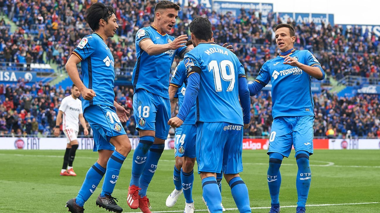 Getafe hammer 10-man Sevilla as Jorge Molina double boosts Champions League chase