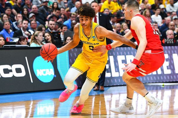Michigan says Jordan Poole staying in draft