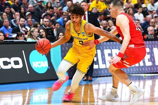 Michigan says Jordan Poole staying in draft