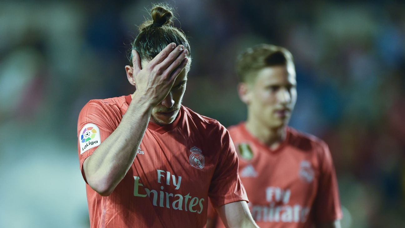 Real Madrid stunned by Rayo Vallecano a day after Barcelona lift La Liga title