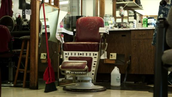 Chancellor swept barber shop floors to help his family