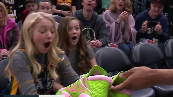 Mitchell gives shoes to girls in stands