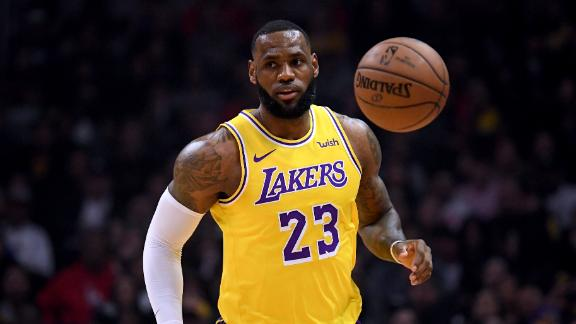 LeBron flirts with triple-double in return