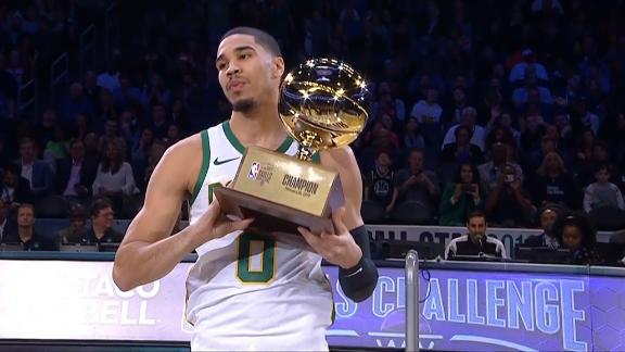 Tatum hits half-court shot to win skills challenge.