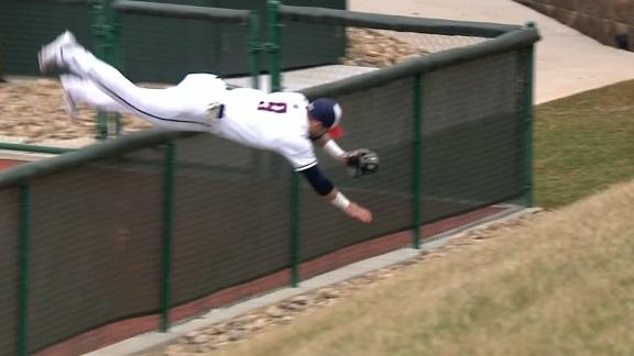 Liberty RF flips over fence after making catch