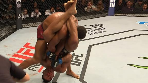 Silva gets slammed, holds on for submission win
