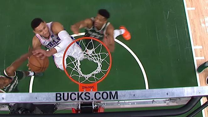 Simmons flies in for putback dunk
